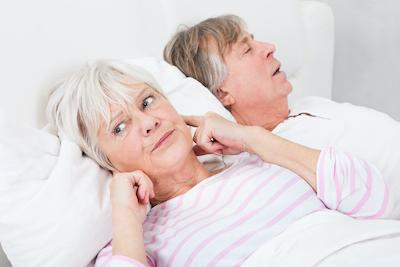 Man snoring with wife awake | Snoring Treatment Fairfax VA Dentist