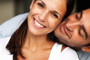 Couple hugging and smiling with teeth whitening in fairfax va