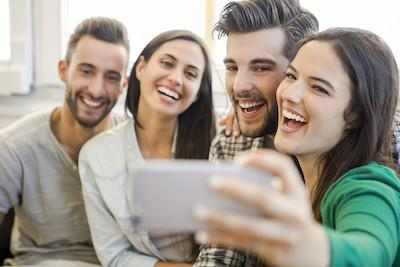 Smiling friends taking a selfie | Veneers at Fairfax Dentist