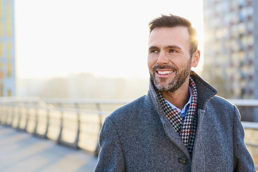 man walking outdoors with veneers in fairfax va